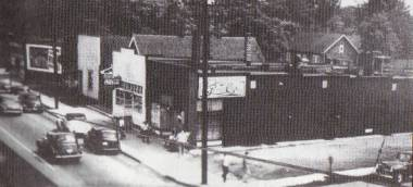Looking southeast on Consaul- John Packo's Cafe with front entrance, John Maroda's Bowling Alley, the office of Dr. Louis Marcus, a residence, and the Kroger Store on the corner