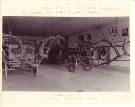 Volunteer Fire Department pumper wagons in the fire station Circa 1885