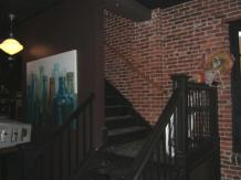 The inside features exposed brick walls